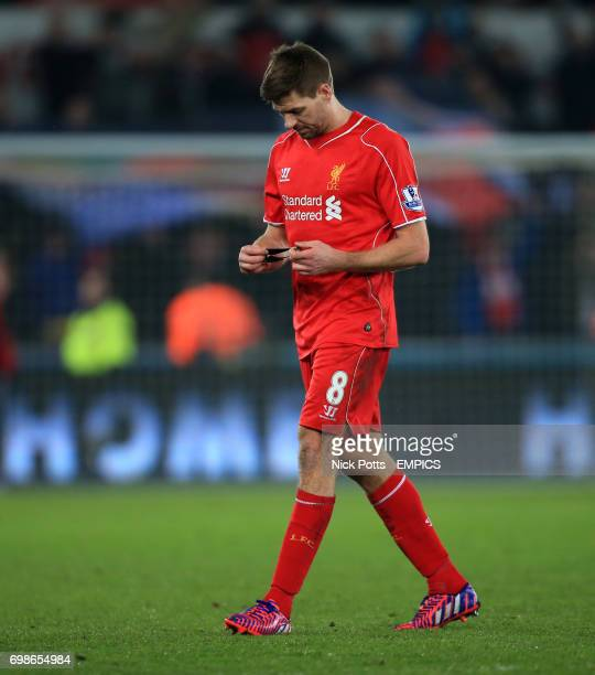 Liverpool's Steven Gerrard after the game looking at his captain's armband
