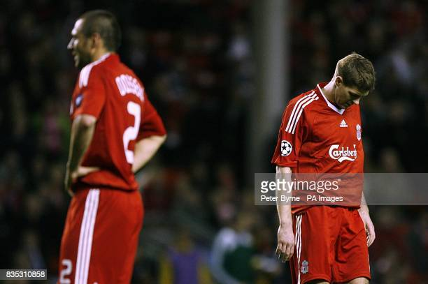 Liverpool's Steven Gerrard and Andrea Dossena stand dejected after the final whistle
