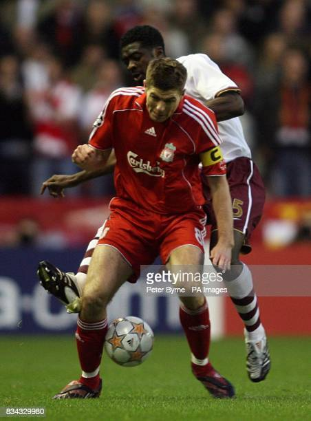 Liverpool'S Steven Gerrard and Arsenal's Kolo Toure battle for the ball