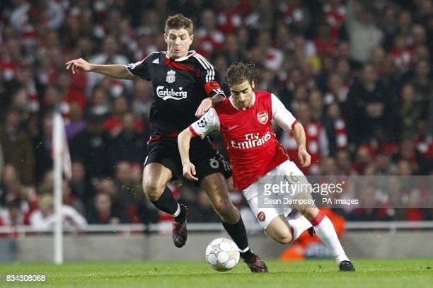Liverpool's Steven Gerrard and Arsenal's Mathieu Flamini battle for the ball