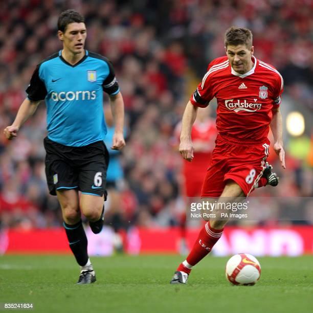 Liverpool's Steven Gerrard and Aston Villa's Gareth Barry battle for the ball