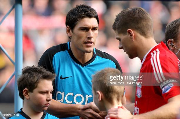 Liverpool's Steven Gerrard and Aston Villa's Gareth Barry shake hands prior to kick off