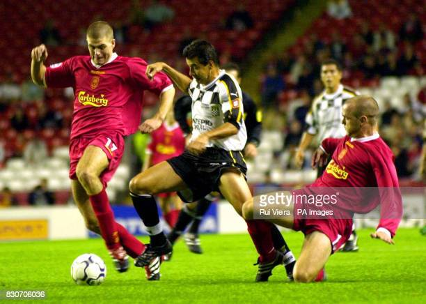 Liverpool's Steven Gerrard and Danny Murphy gets away from Pedro Emanuel of Boavista during the UEFA Champions League Group B game between Liverpool...
