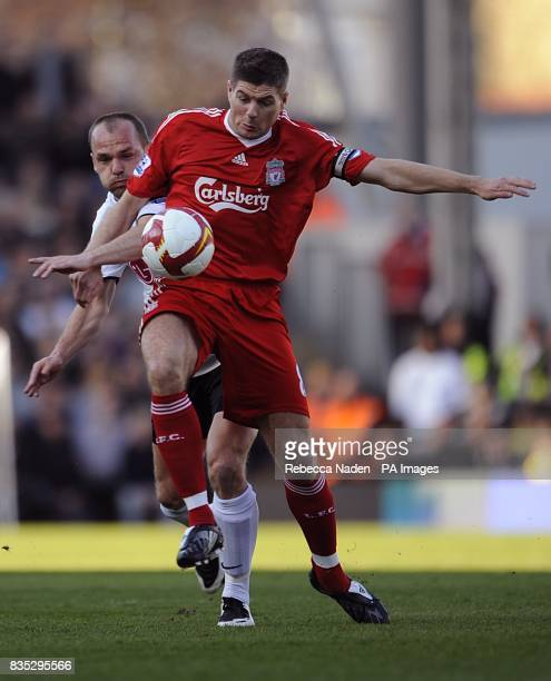 Liverpool's Steven Gerrard and Fulham's Danny Murphy battle for the ball