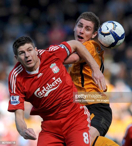 Liverpool's Steven Gerrard and Hull City's Tom Cairney in action