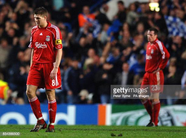 Liverpool's Steven Gerrard and Jamie Carragher stand dejected after Chelsea take the lead