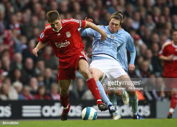 Liverpool's Steven Gerrard and Manchester City's Michael Johnson battle for the ball