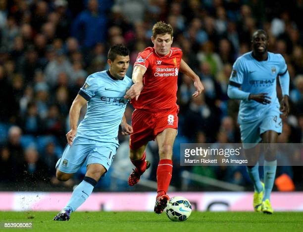 Liverpool's Steven Gerrard and Manchester City's Sergio Aguero battle for the ball during the Barclays Premier League match at the Etihad Stadium...