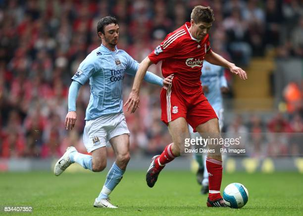 Liverpool's Steven Gerrard and Manchester City's Stephen Ireland battle for the ball