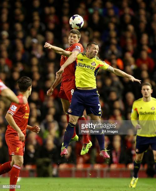 Liverpool's Steven Gerrard and Sunderland's Phil Bardsley battle for the ball in the air