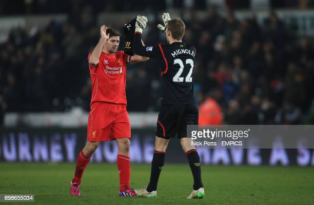 Liverpool's Steven Gerrard celebrates 10 win over Swansea City with Liverpool goalkeeper Simon Mignolet