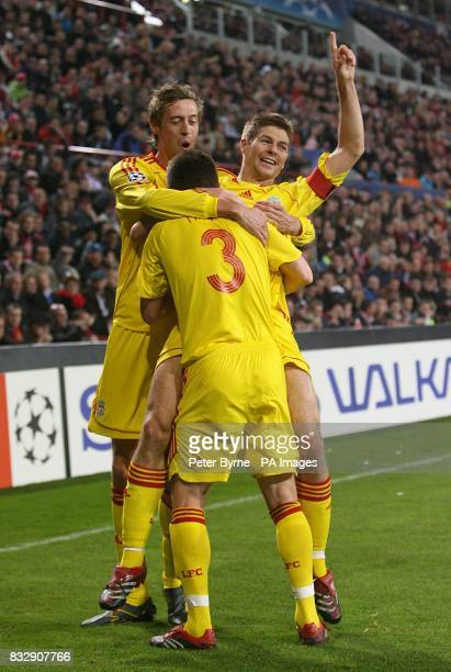 Liverpool's Steven Gerrard celebrates his goal with team mates Peter Crouch and Steve Finnan