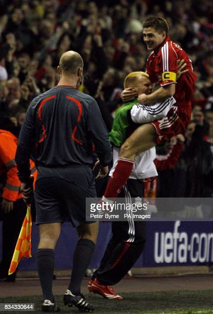 Liverpool's Steven Gerrard celebrates on the touchline with team mate John Arne Riise after scoring the fifth goal of the game from the penalty spot