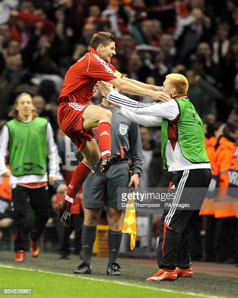 Liverpool's Steven Gerrard celebrates scoring fifth goal of the match with team mate John Arne Riise