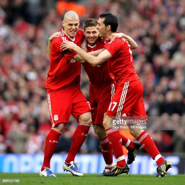 Liverpool's Steven Gerrard celebrates scoring his sides third goal