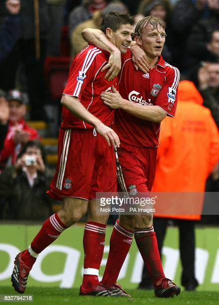 Liverpool's Steven Gerrard celebrates scoring the fourth goal of the game with team mate Dirk Kuyt