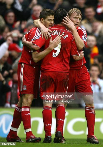 Liverpool's Steven Gerrard celebrates scoring the fourth goal of the game with team mates Dirk Kuyt and Robbie Fowler
