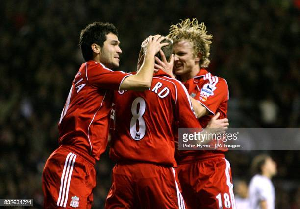Liverpool's Steven Gerrard celebrates scoring the opening goal with teammates Sanz Luis Garcia and Dirk Kuyt