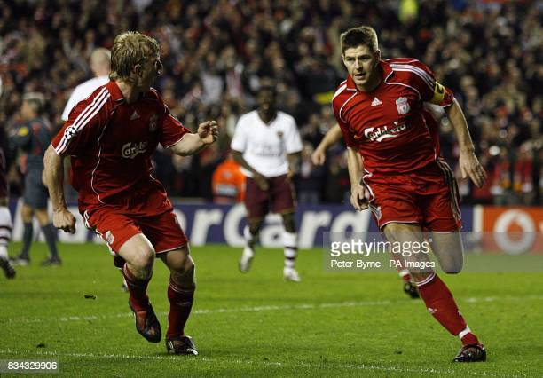 Liverpool's Steven Gerrard celebrates with team mate Dirk Kuyt after scoring the fifth goal of the game from the penalty spot