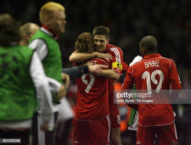 Liverpool's Steven Gerrard celebrates with team mate Fernando Torres after scoring the fifth goal of the game from the penalty spot