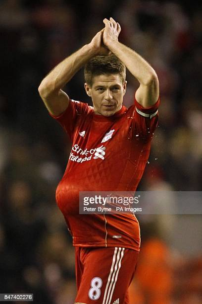 Liverpool's Steven Gerrard celebrates with the matchball after the game