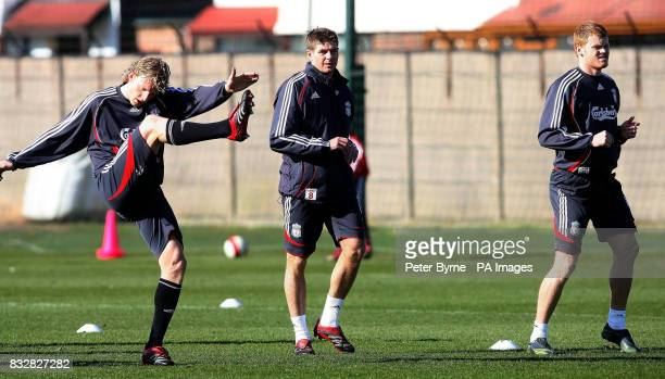 Liverpool's Steven Gerrard centre Dirk Kuyt and John Arne Riise during a training session at Melwood Training Complex Liverpool