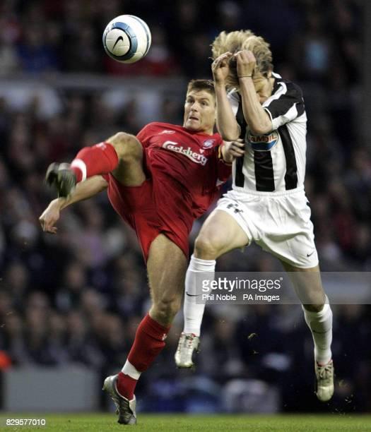 Liverpool's Steven Gerrard challenges Juventus' Pavel Nedved