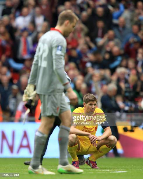 Liverpool's Steven Gerrard crouches dejected after the match