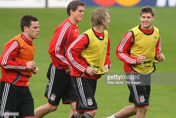 Liverpool's Steven Gerrard Dirk Kuyt Daniel Agger and Steve Finnan during training