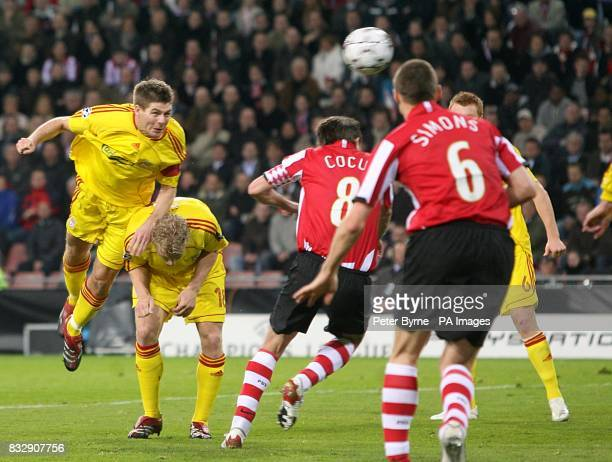 Liverpool's Steven Gerrard heads in the first goal