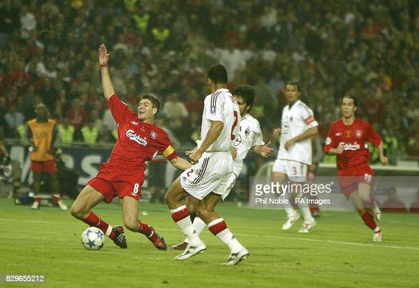 Liverpool's Steven Gerrard is brought down by AC Milan's Gennaro Ivan Gattuso to get a penalty