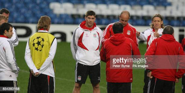 Liverpool's Steven Gerrard listens to Rafael Benitez during the training session at Stamford Bridge London