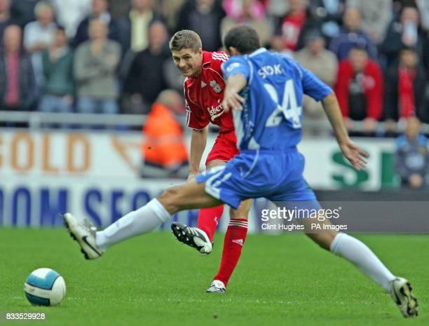 Liverpool's Steven Gerrard looks to get a ball past Wigan's Josip Skoko during the Barclays Premier League match at the JJB Stadium Wigan