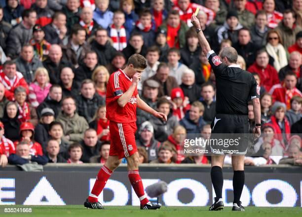 Liverpool's Steven Gerrard recieves a yellow card