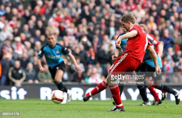 Liverpool's Steven Gerrard scores his sides third goal of the game