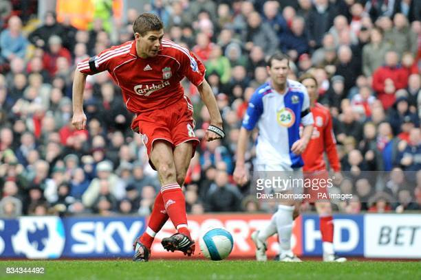 Liverpool's Steven Gerrard scores the opening goal of the game