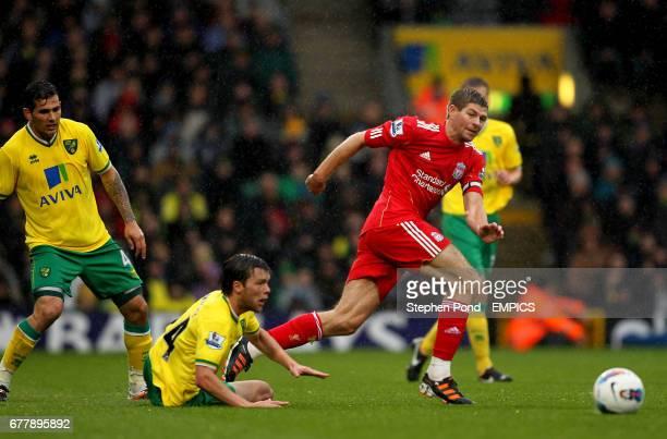 Liverpool's Steven Gerrard skips past Norwich City's Jonny Howson