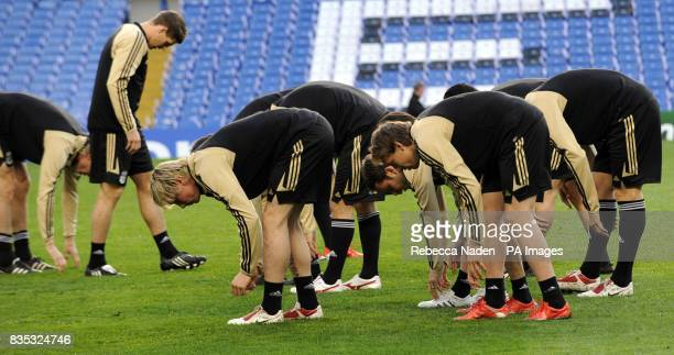 Liverpool's Steven Gerrard warms up with his teammates during a Training Session at Stamford Bridge London