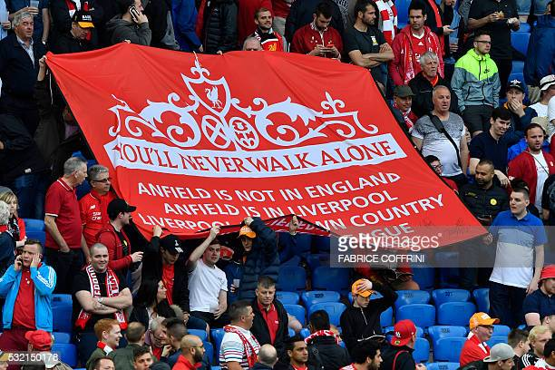 Liverpool's supporters hold a banner reading 'you'll never walk alone' prior to the UEFA Europa League final football match between Liverpool FC and...