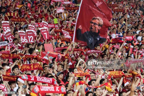 Liverpool's supporters wave a flag of manager Jurgen Klopp during the final of the Premier League Asia Trophy football tournament between Liverpool...