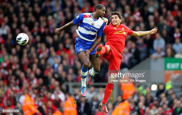 Liverpool's Suso and Reading's Mikele Leigertwood battle for the ball during the Barclays Premier League match at Anfield Liverpool