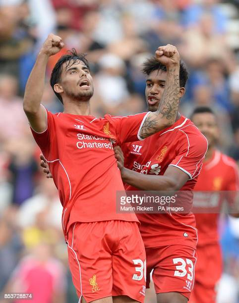 Liverpool's Suso celebrates scoring his teams 1st goal against Preston North End with Liverpool's Jordan Ibe during the PreSeason friendly at...