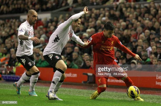 Liverpool's Suso in action with Fulham's Sascha Riether and Ashkan Dejagah