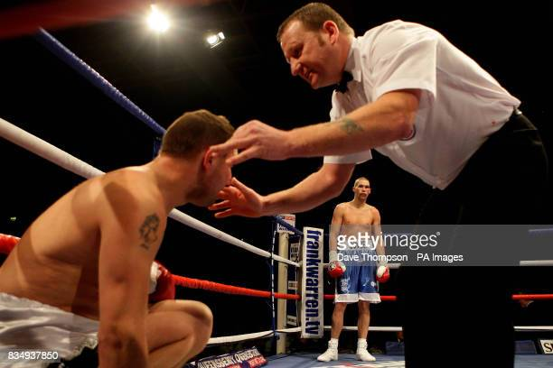 Liverpool's Tony Bellew waits in the corner as Hull's Phil Goodwin is counted out by the referee during the LightHeavyweight Contest at the Kingsway...