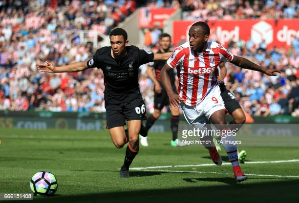 Liverpool's Trent AlexanderArnold and Stoke City's Saido Berahino battle for the ball during the Premier League match at the bet365 Stadium Stoke