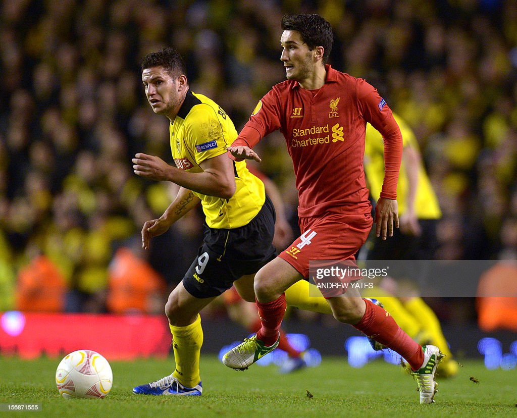 Liverpool's Turkish midfielder Nuri Sahin (R) vies with BSC Young Boys' Argentinian forward Raul Bobadilla (L) during the UEFA Europa League group A football match between Liverpool and BSC Young Boys at Anfield in Liverpool, north-west England on November 22, 2012. AFP PHOTO / ANDREW YATES