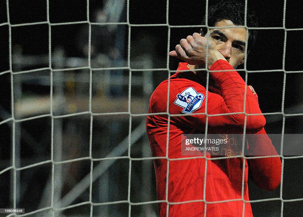 "Liverpool's Uruguayan forward Luis Suarez celebrates after scoring his team's second goal during the FA Cup third round football match between Mansfield Town and Liverpool at Field Mill in Mansfield, central England, on January 6, 2013. Liverpool won the match 2-1. USE. No use with unauthorized audio, video, data, fixture lists, club/league logos or ""live"" services. Online in-match use limited to 45 images, no video emulation. No use in betting, games or single club/league/player publications."