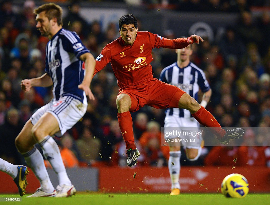 """Liverpool's Uruguayan forward Luis Suarez shoots the ball during the English Premier League football match between Liverpool and West Bromwich Albion at Anfield in Liverpool, northwest England on February 11, 2013. West Bromwich won the match 2-0. AFP PHOTO/ANDREW YATES === RESTRICTED TO EDITORIAL USE. No use with unauthorized audio, video, data, fixture lists, club/league logos or """"live"""" services. Online in-match use limited to 45 images, no video emulation. No use in betting, games or single club/league/player publications ==="""