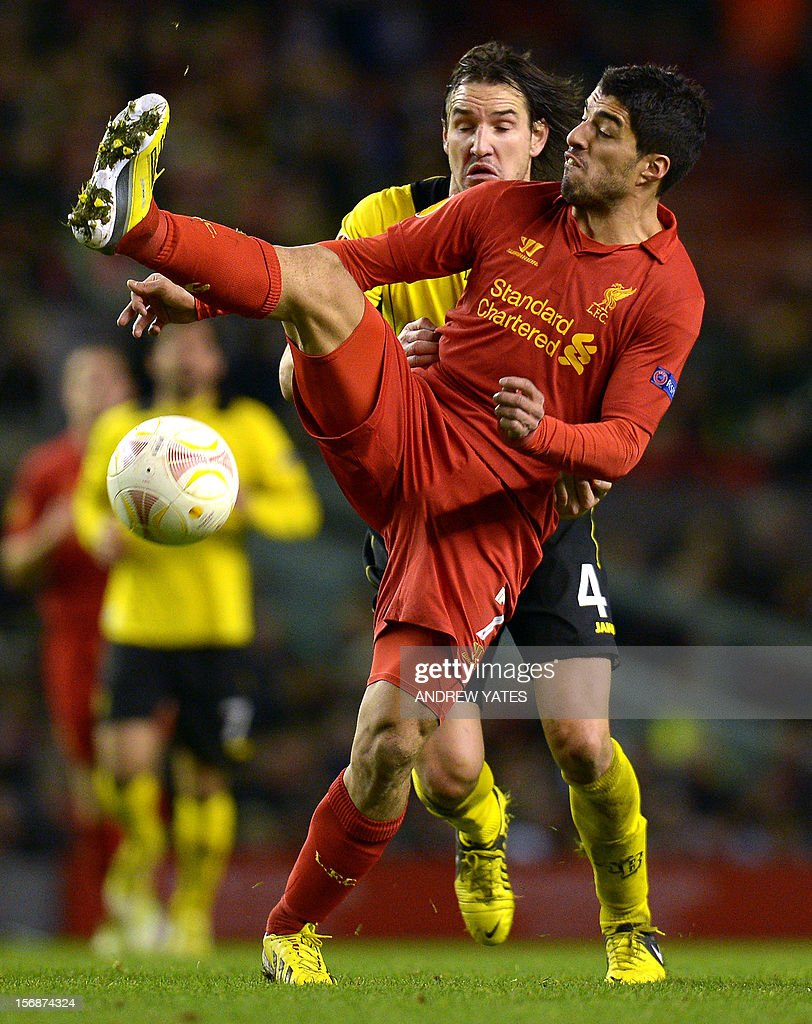 Liverpool's Uruguayan forward Luis Suarez (R) vies with BSC Young Boys Swiss defender Alain Nef (L) during the UEFA Europa League group A football match between Liverpool and BSC Young Boys at Anfield in Liverpool, north-west England on November 22, 2012.