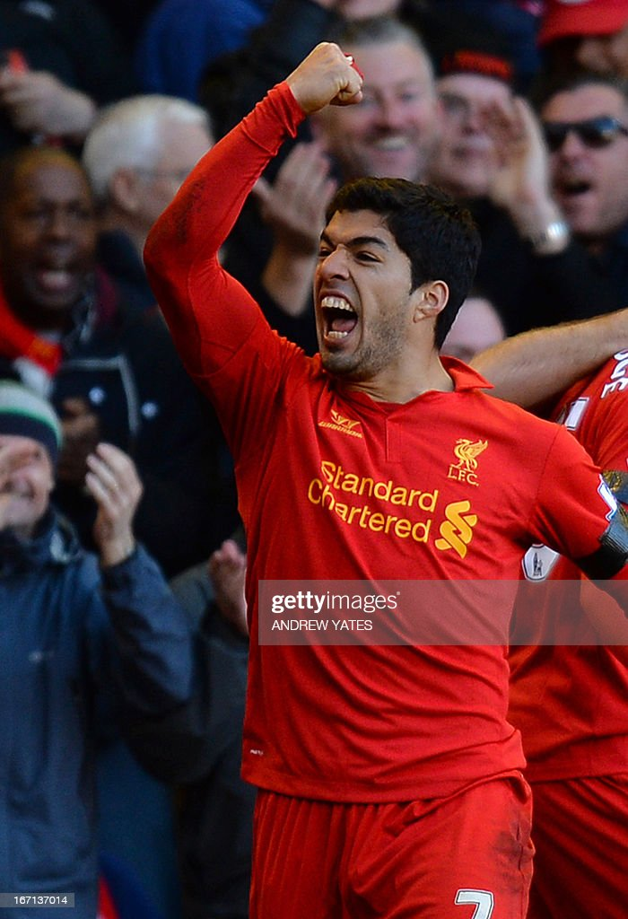 Liverpool's Uruguayan striker Luis Suarez celebrates scoring their late equalizer during the English Premier League football match between Liverpool and Chelsea at the Anfield stadium in Liverpool, northwest England, on April 21, 2013. The game finished 2-2. USE. No use with unauthorized audio, video, data, fixture lists, club/league logos or live services. Online in-match use limited to 45 images, no video emulation. No use in betting, games or single club/league/player publications.